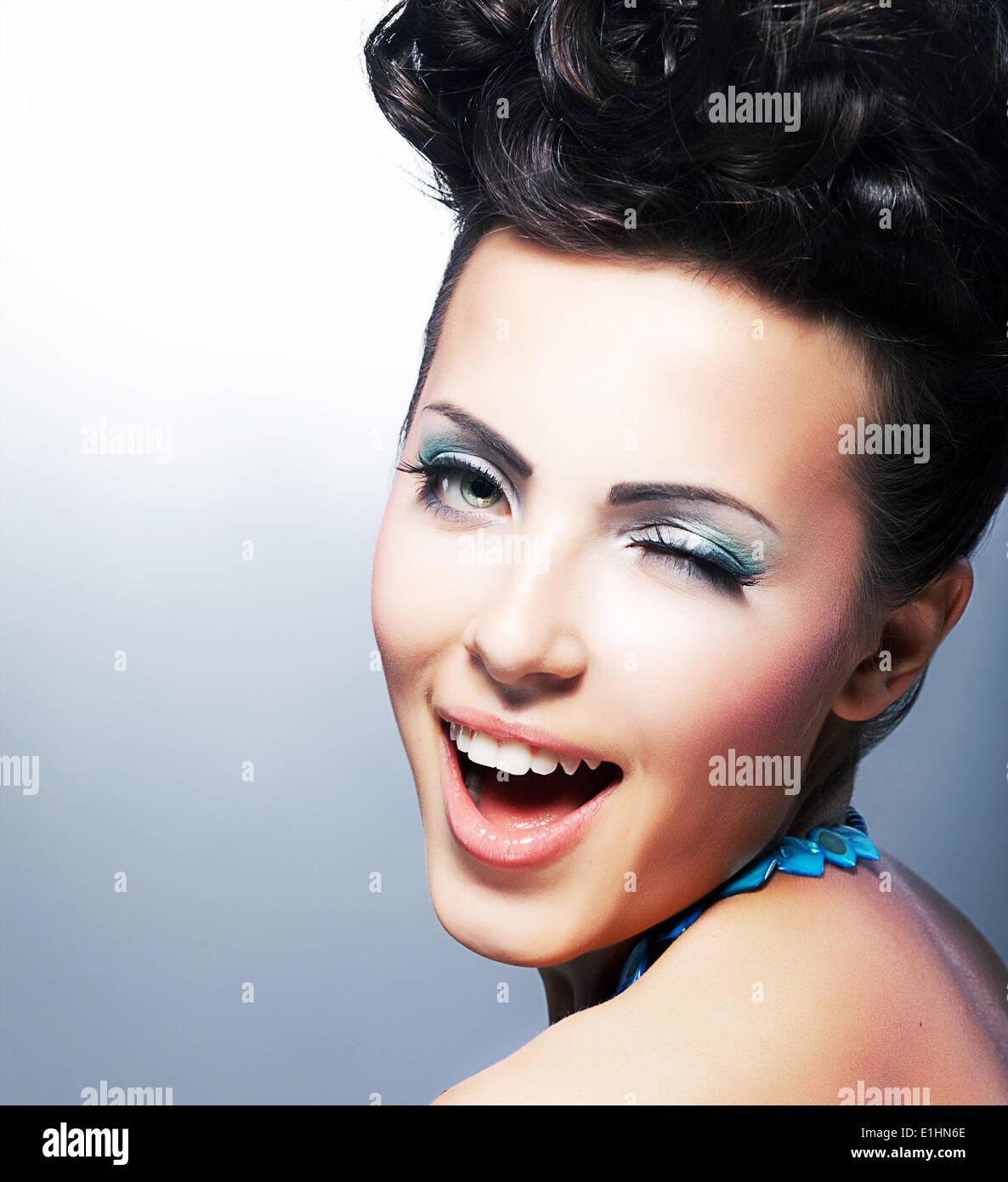 Delight. Happy Flirtatious Coquette smiling. Quizzical Smile - Stock Image