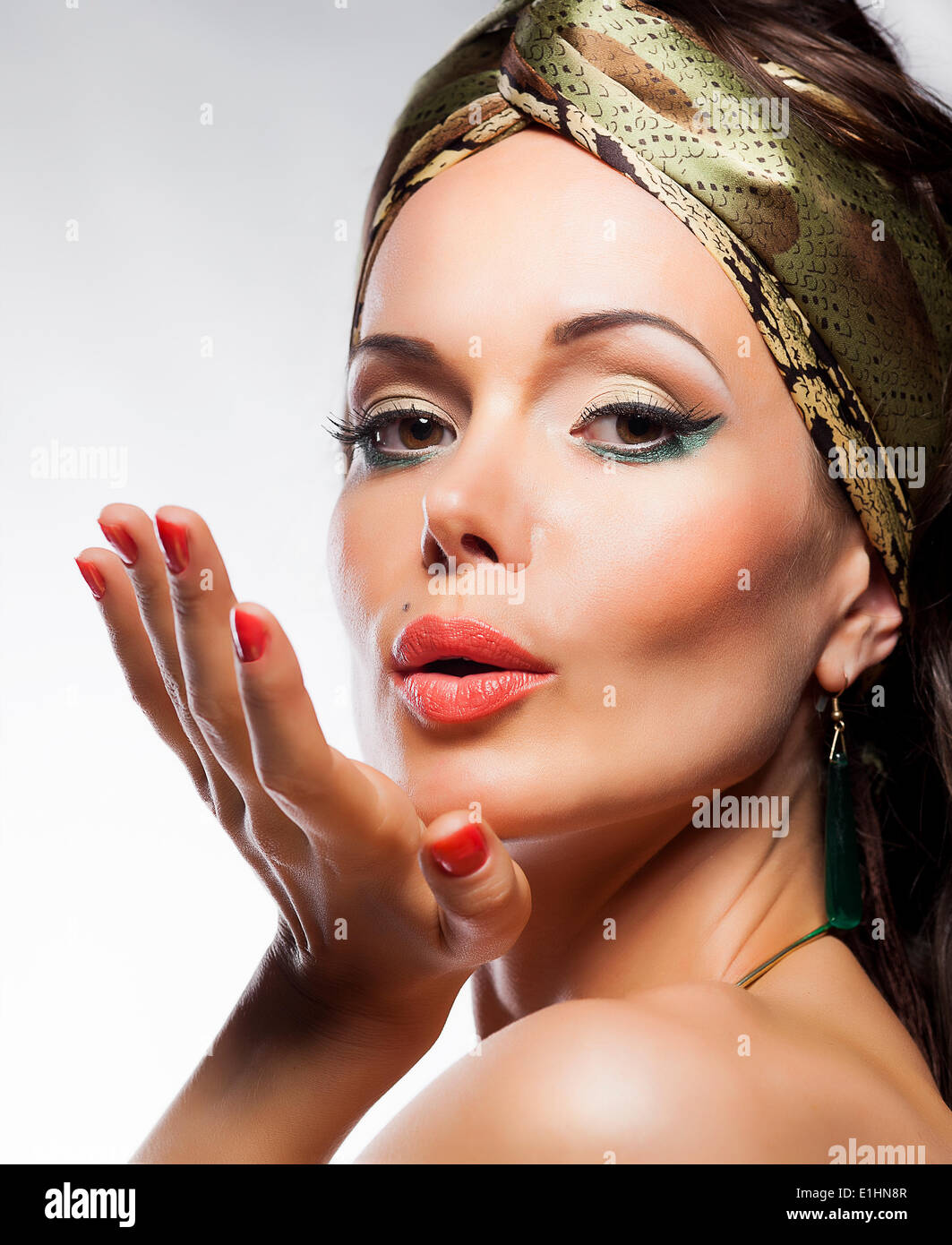 Oriental fashion style. Beautiful woman magic face. Blowing a kiss - Stock Image