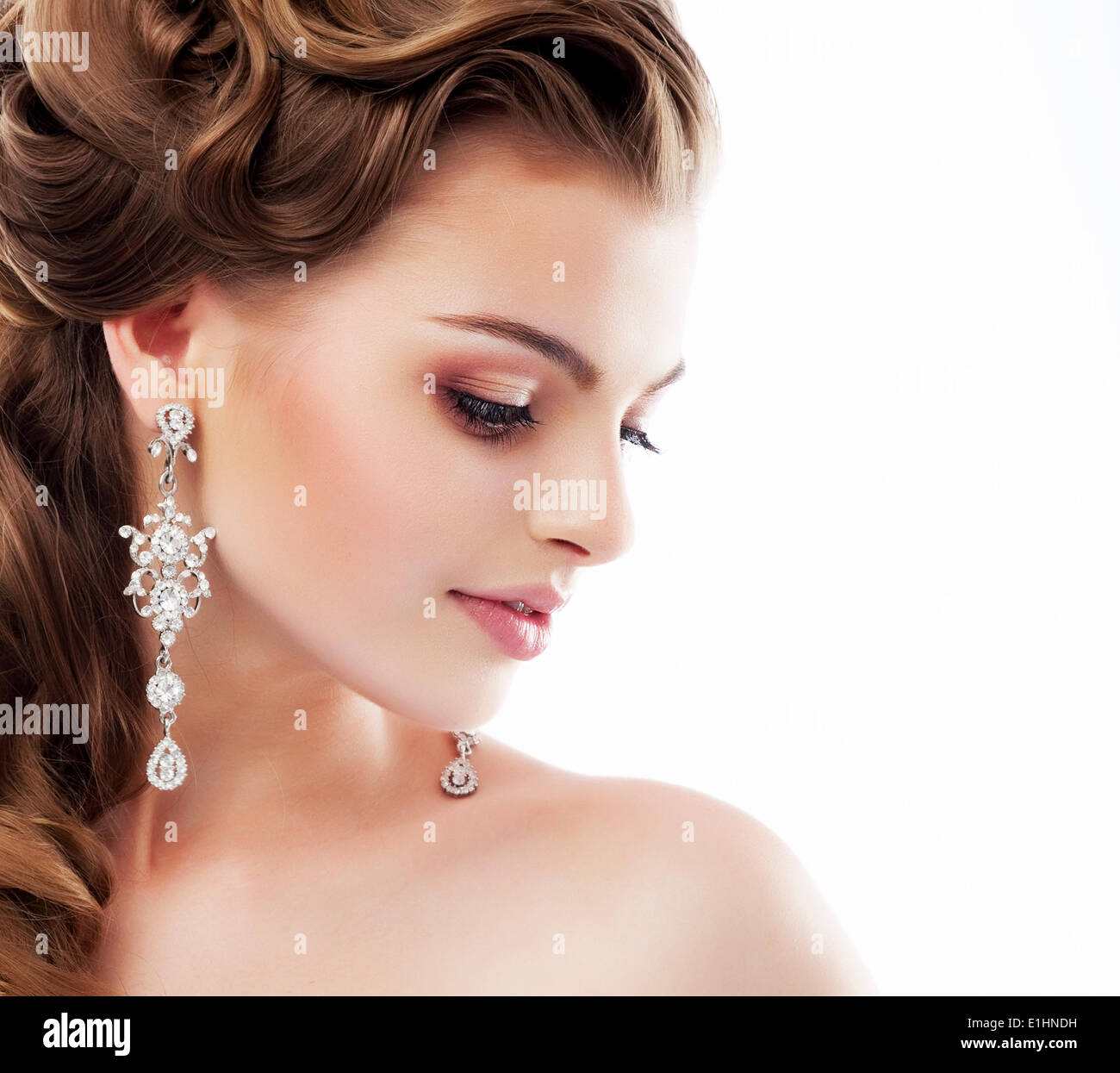 Pure Beauty. Aristocratic Profile of smiling Lady with Glossy Diamond Earrings. Femininity & Sophistication - Stock Image