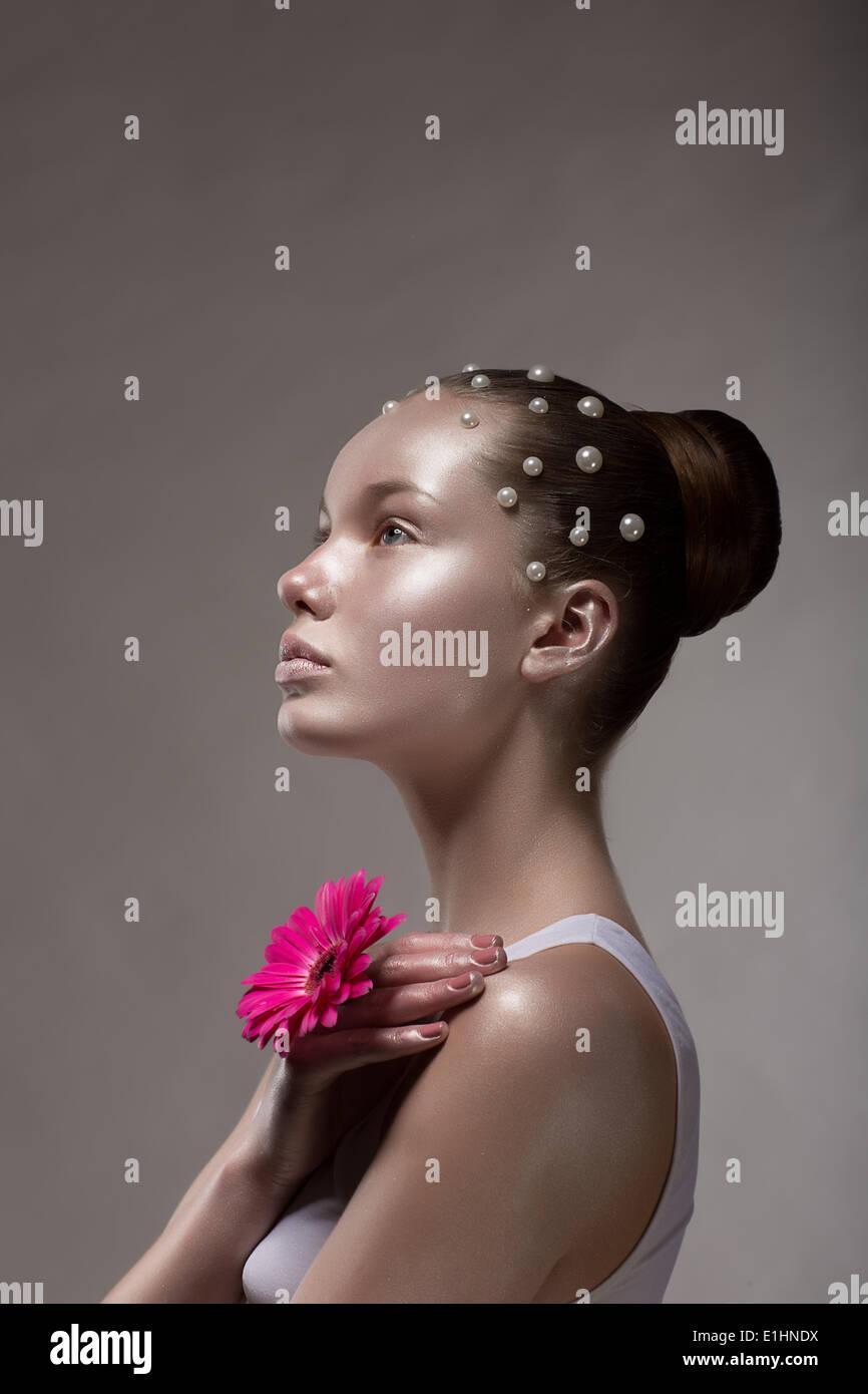 Bronze Body Art. Profile of Brown Tanned Woman's Face. Creative Futuristic Portrait - Stock Image