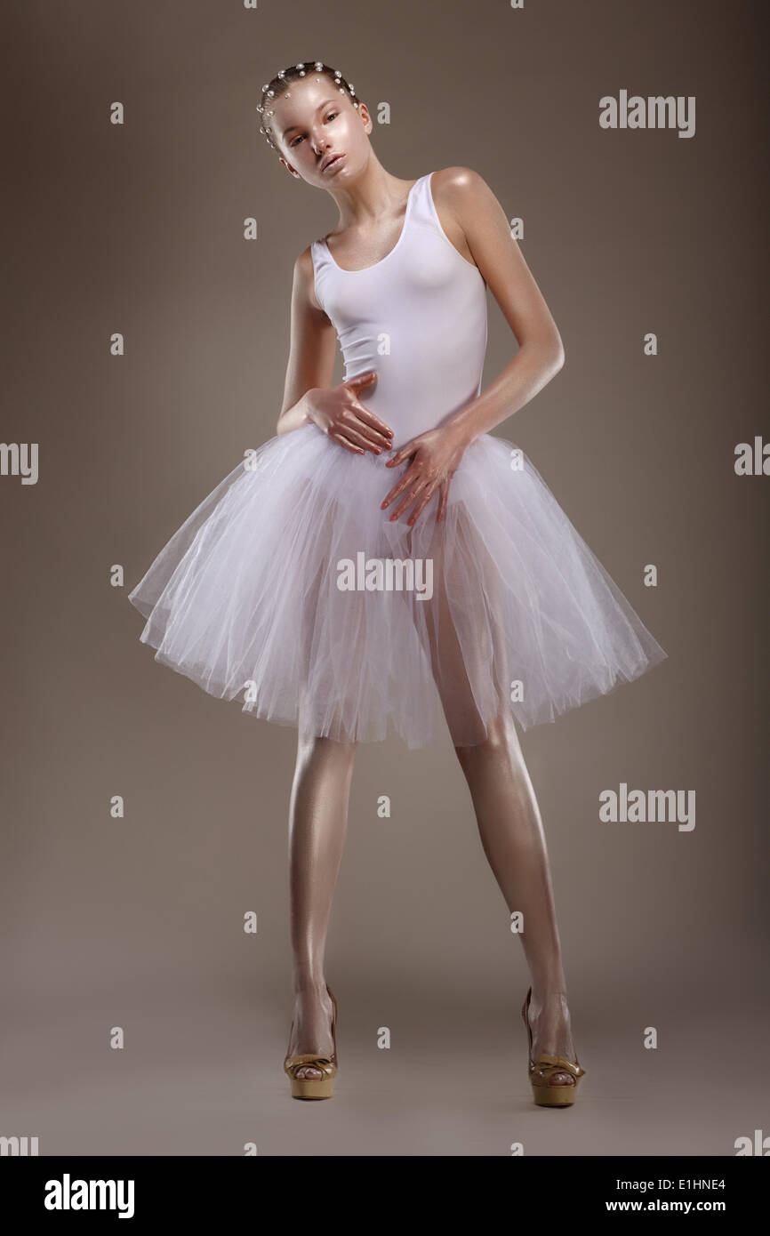 Full length of Tranquil Asian Woman in White Dress. Sensuality Stock Photo