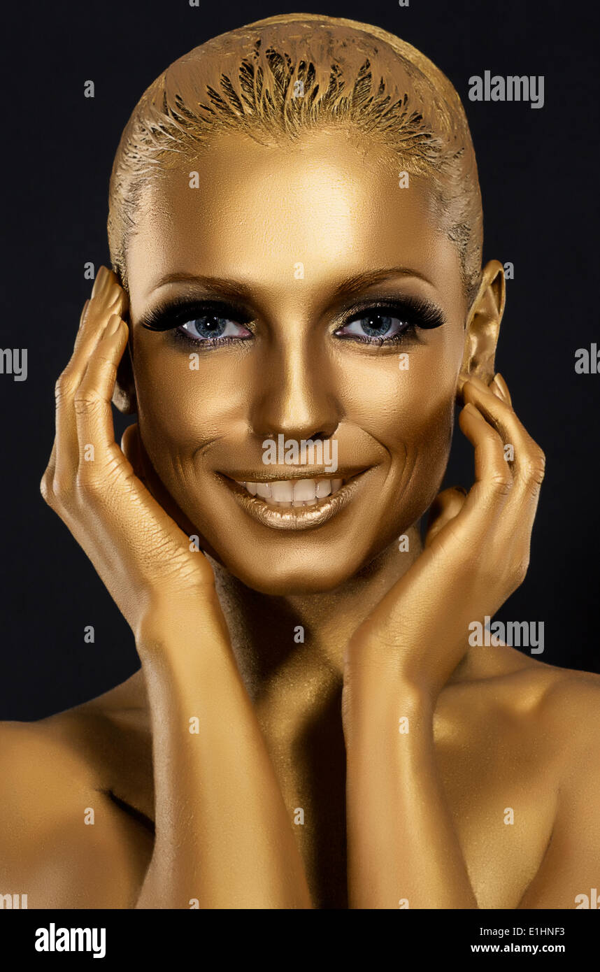 Coloring & Glance. Gorgeous Woman smiling. Fantastic Golden Makeup. Art - Stock Image