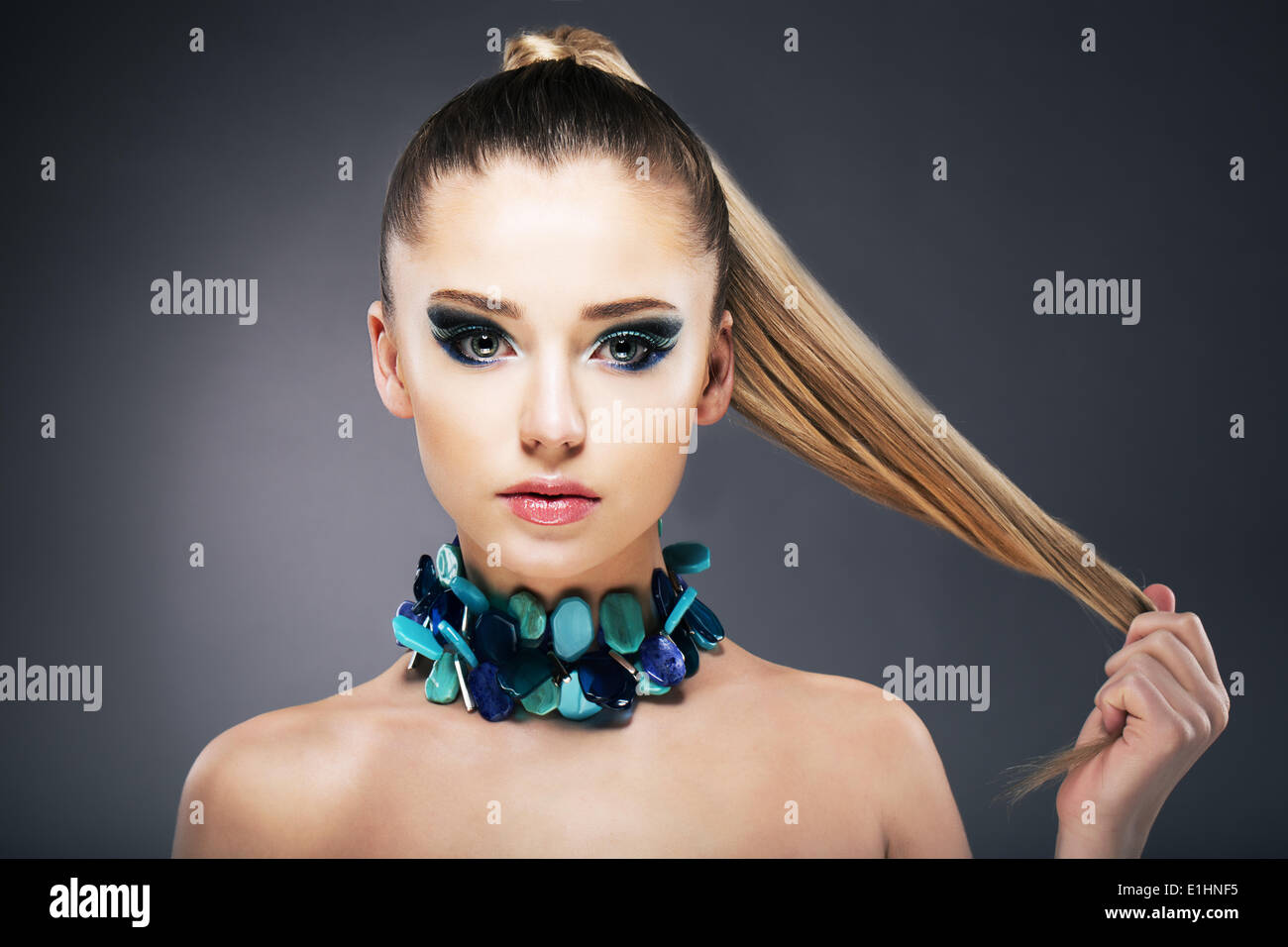 Treatment. Woman holding Tips of her long faint Hair in hand - Stock Image