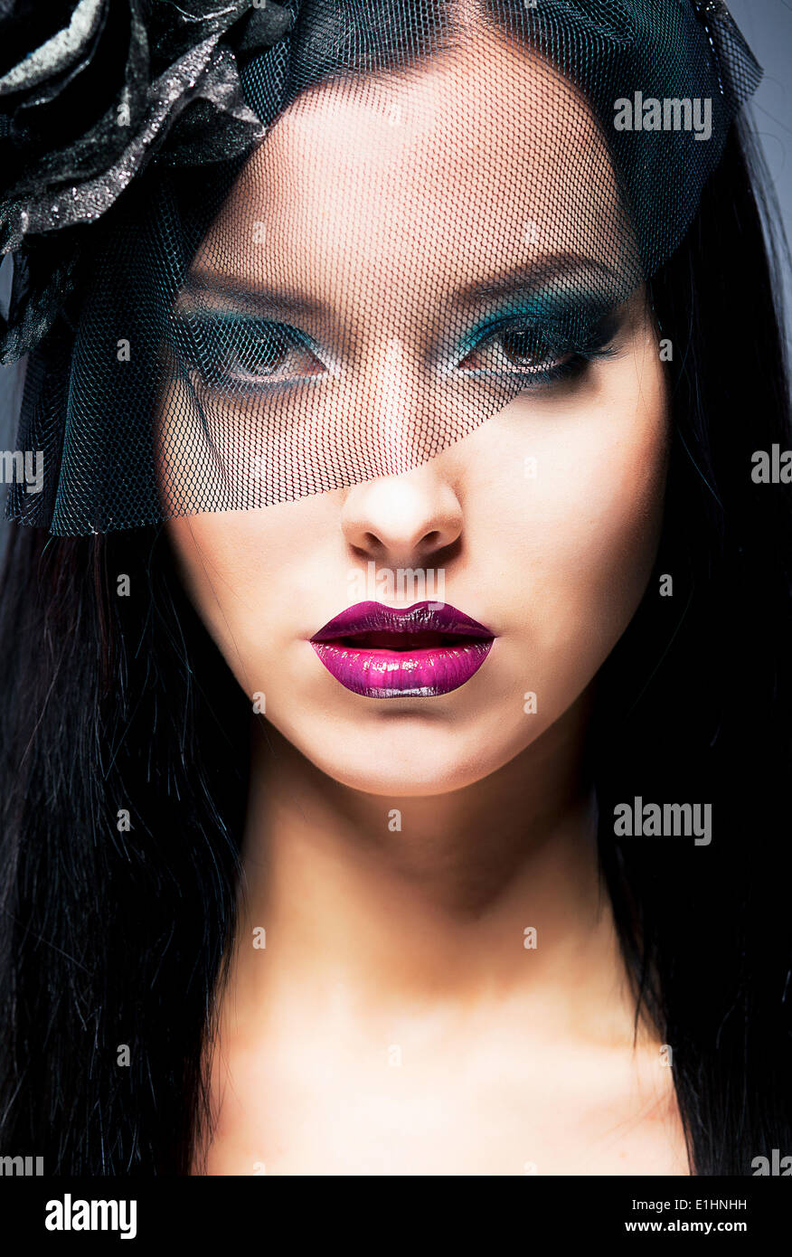 Close-up female widow with black mourning veil - Stock Image
