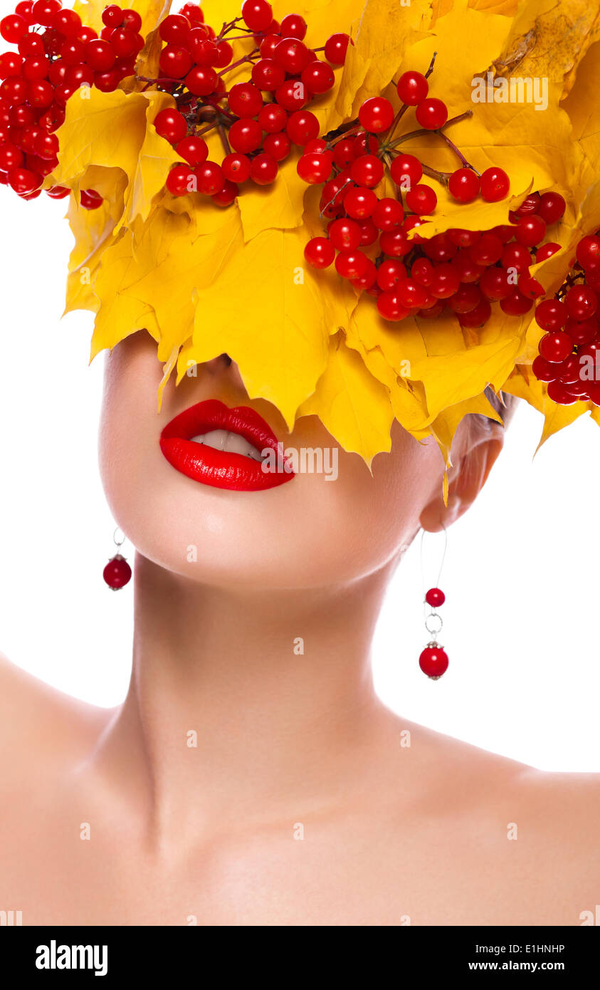 Autumn beautiful female. Natural makeup. Yellow leaves and berries - Stock Image