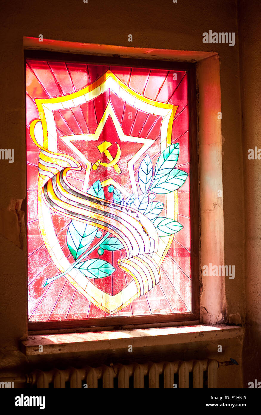 Red star, hammer and sickle, laurel wreath and sabers (swords). Heraldic composition - Stock Image