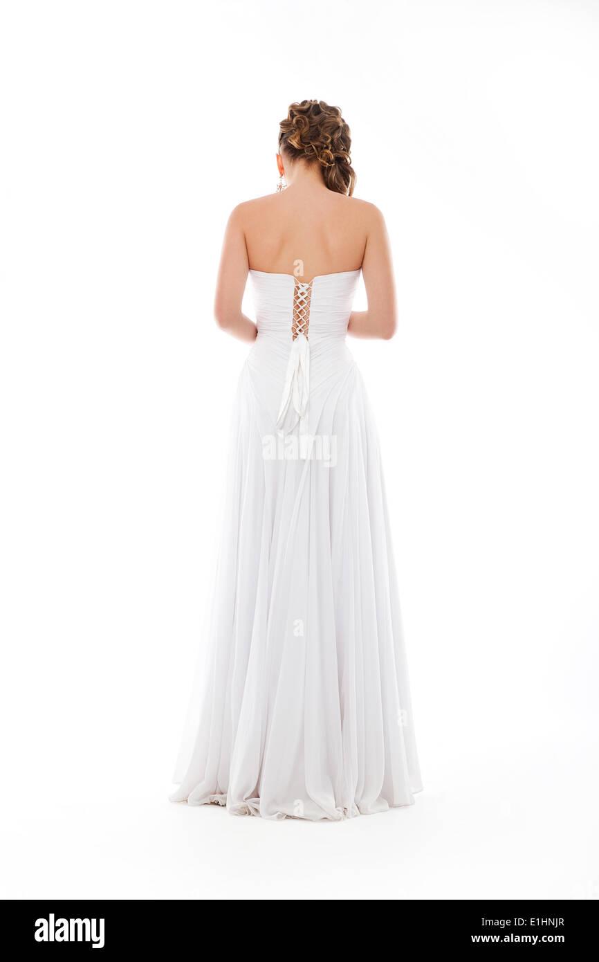 Happy beautiful bride back. Beautiful shoulders. White wedding dress - Stock Image