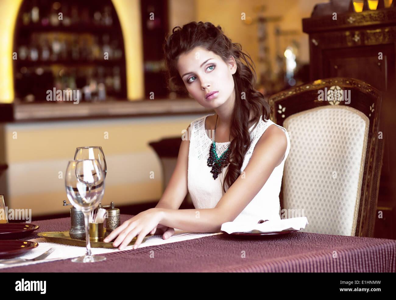 Luxury. Classy Romantic Woman in Restaurant. Expectancy - Stock Image