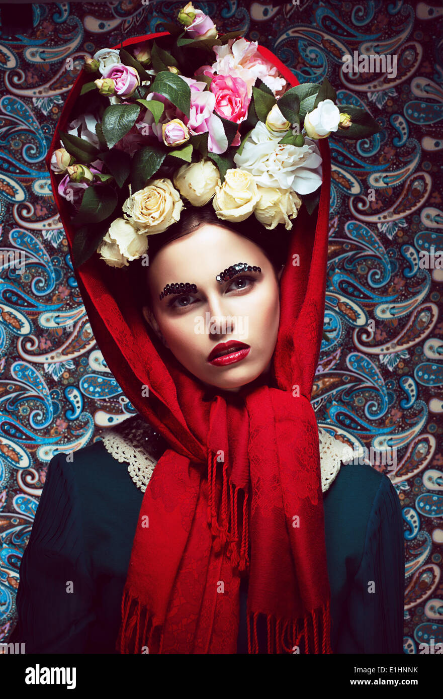 Vintage. Woman in Red Shawl and wreath of Roses. Retro - Stock Image