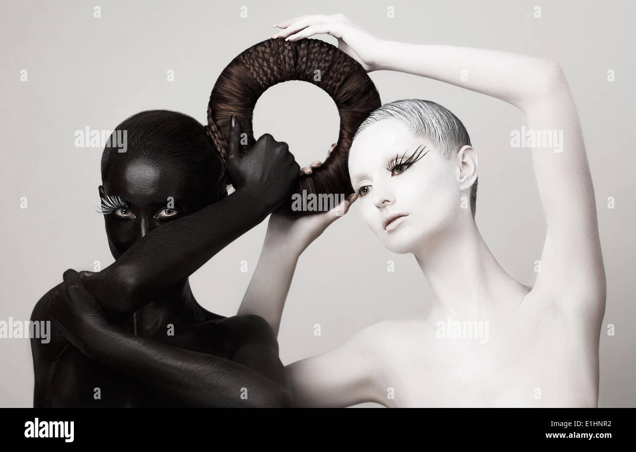 Women in Ying Yang Style. Occult Contrast Make-up. Unity - Stock Image