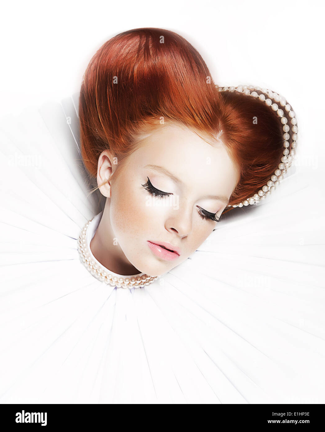 Renaissance style - dreamy cute female - redhead freckled girl with pearly necklace and stagy dramatic make up. Series of photos - Stock Image