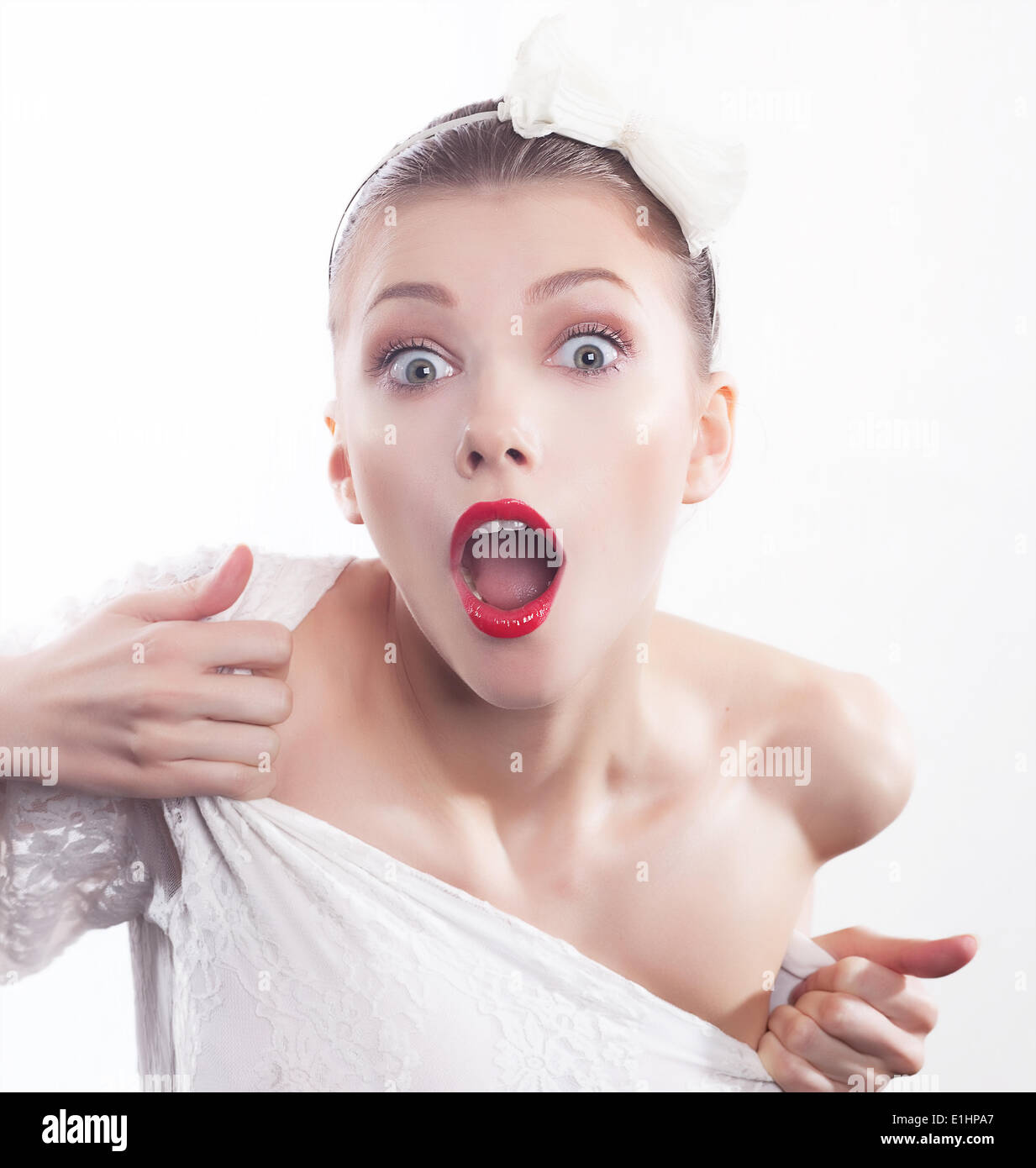 Excited shouting young pretty woman isolated on white background - Stock Image