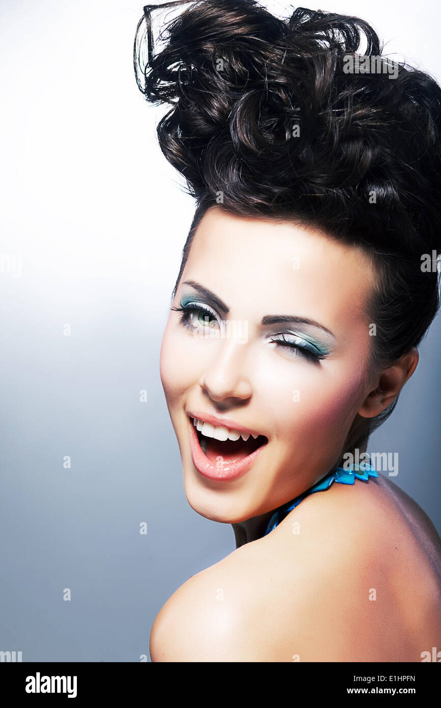 Beautiful young laughing shopper female - toothy smile - Stock Image
