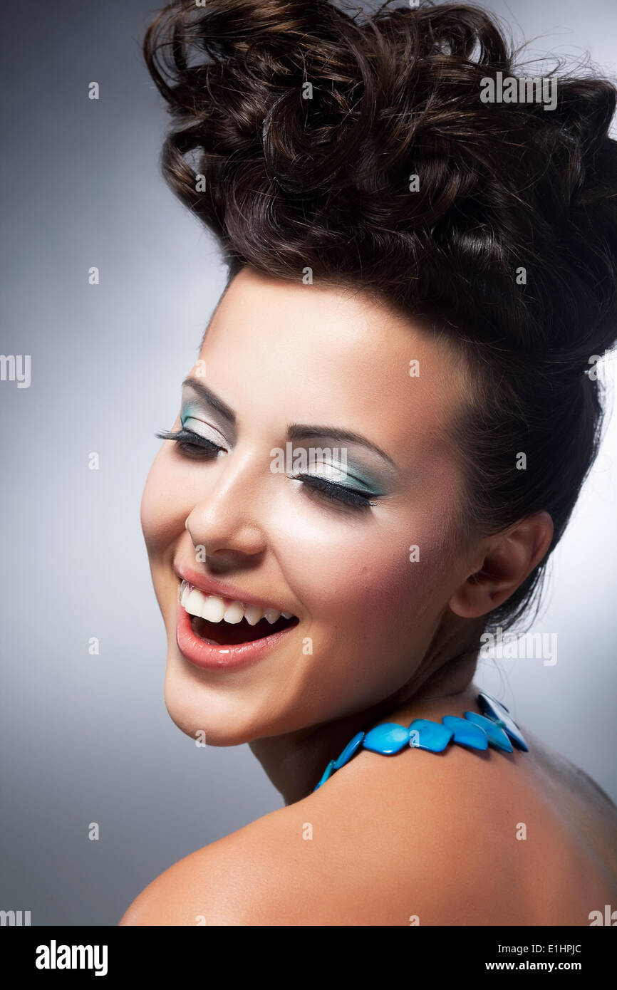 Delight. Elation. Beautiful young happy woman laughing with joy. Styling hairstyle. Shopping and discounts concept - Stock Image