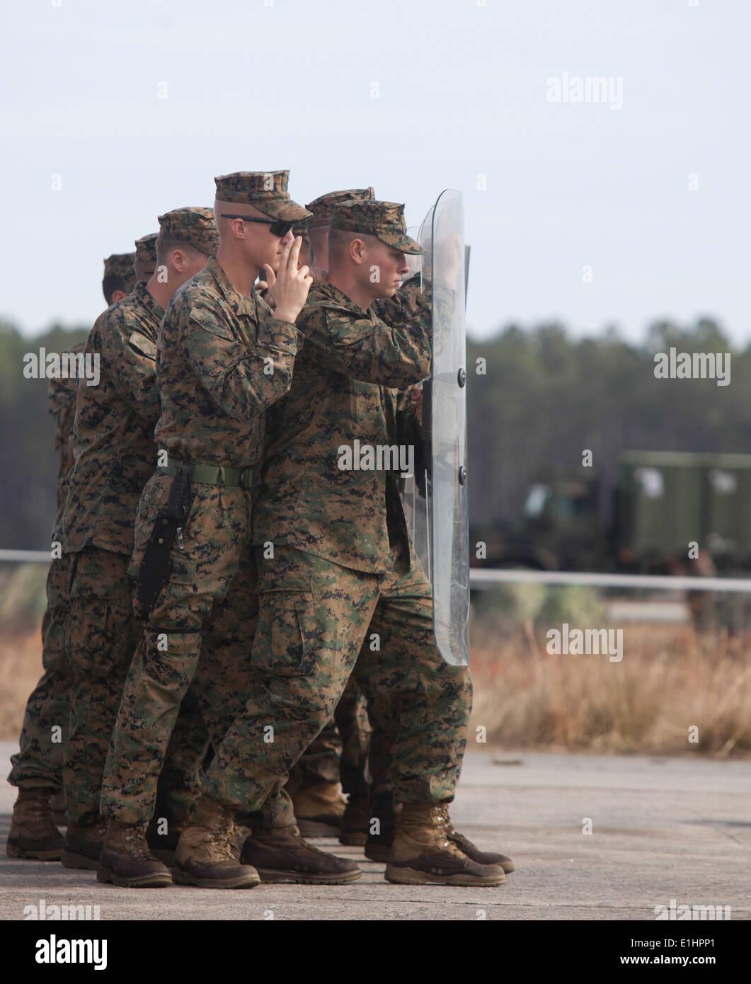 U.S. Marines and sailors assigned to Black Sea Rotational Force-13 (BSRF-13) conduct civil disturbance/riot control drills duri - Stock Image