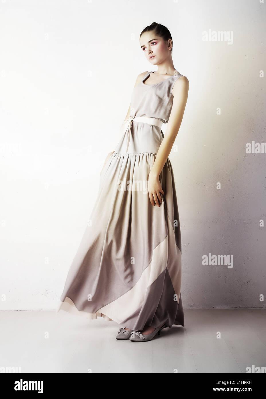Romantic young woman beauty wearing white fashion dress - Stock Image