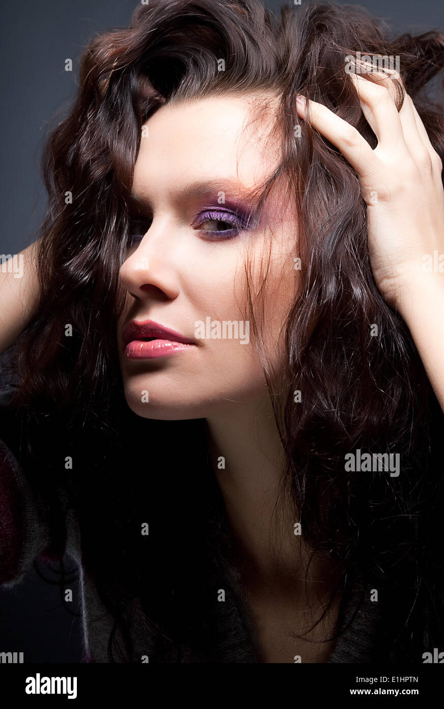 Fashion hairdressing - beauty face of brunette pretty girl - Stock Image
