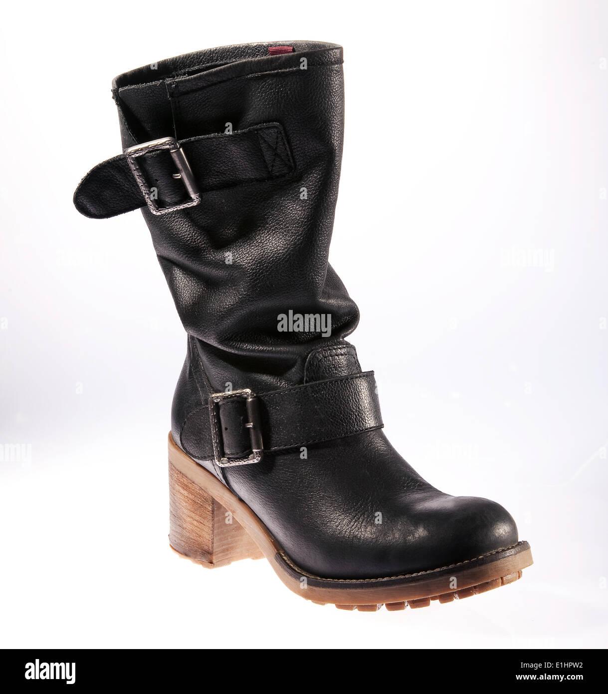 One black leather female boot isolated on white background - Stock Image