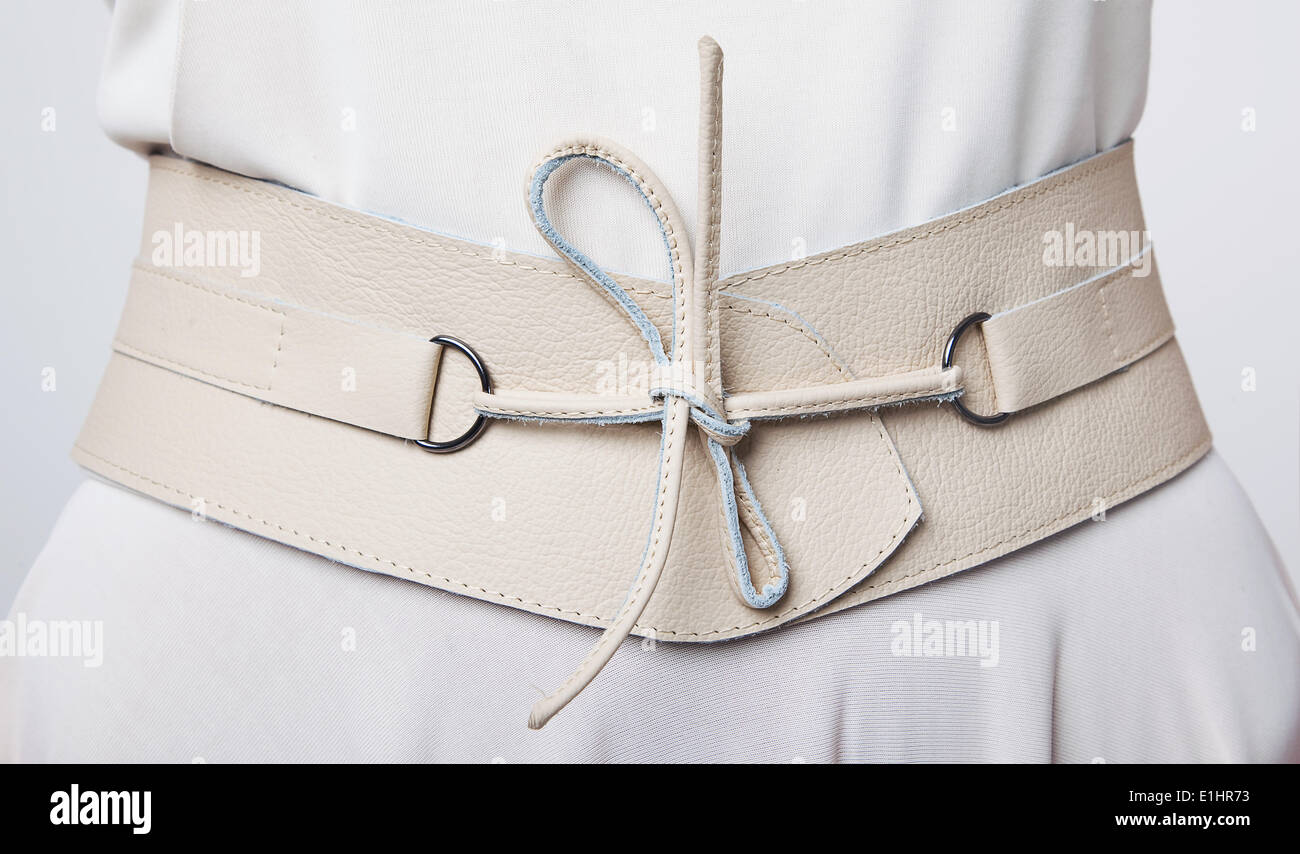 Fashion. Women's beige leather wide belt with lacing - Stock Image
