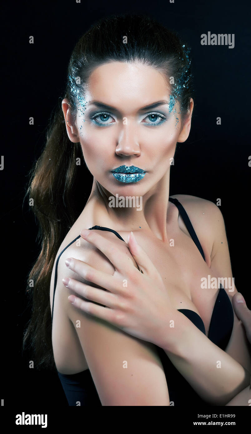 Fashion concept. Beauty woman face with bright blue makeup - Stock Image
