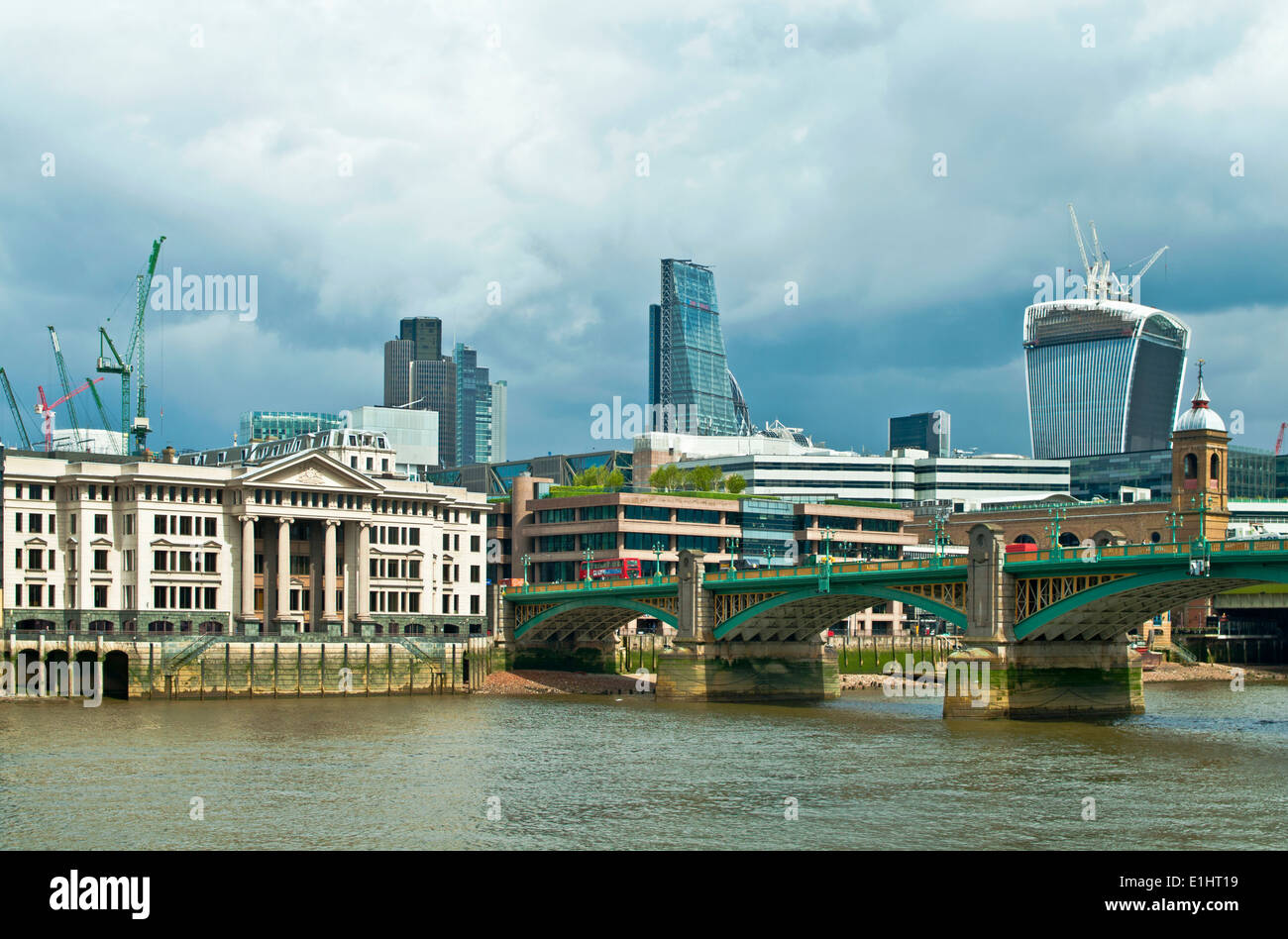 Vintners' Hall, Southwark Bridge, the Cheese Grater and the Walkie Talkie skyscrapers seen across the Thames from the Southbank - Stock Image