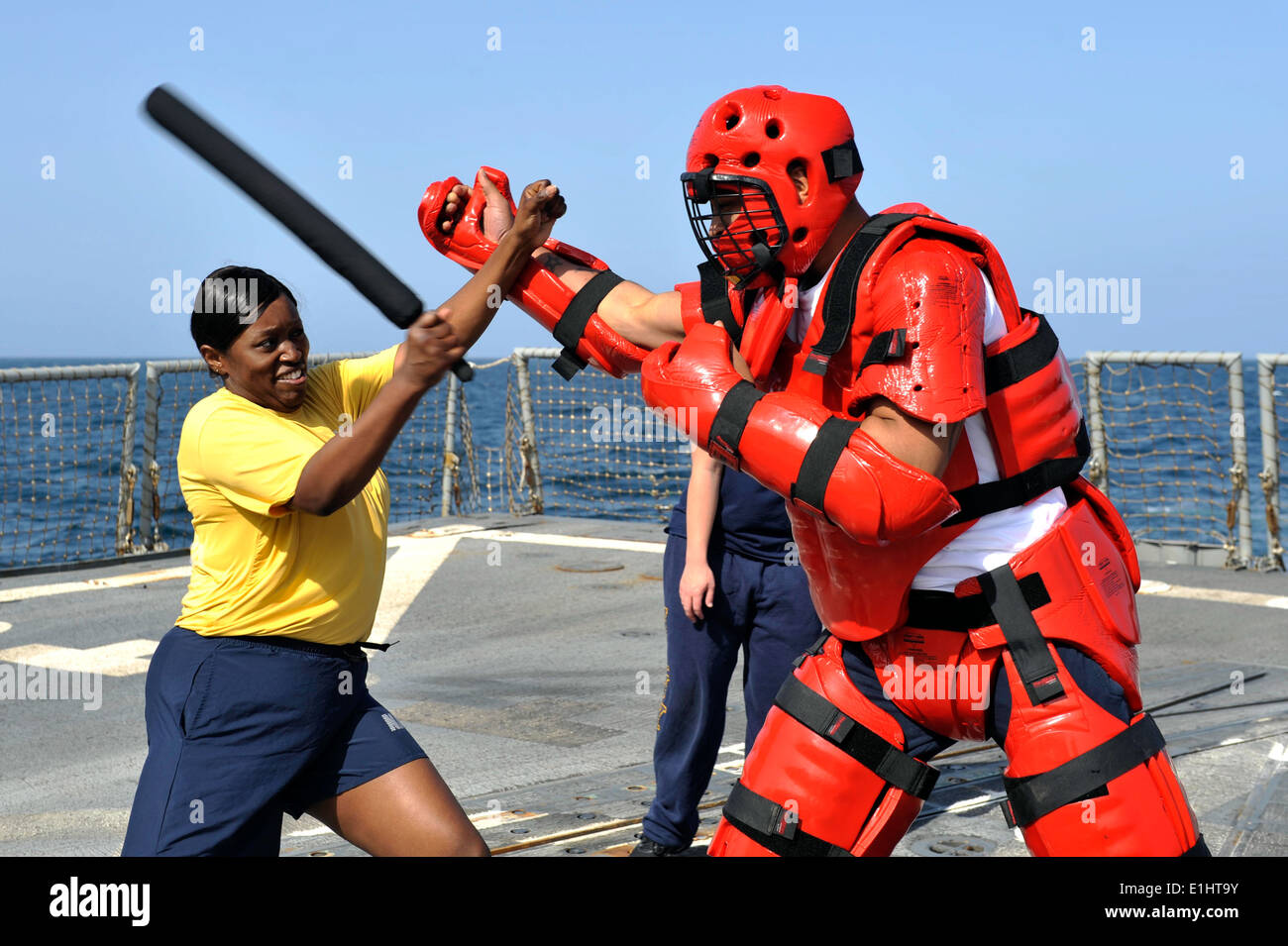 Yeoman 1st Class Charma Smalls, left, practices nonlethal tactics on Information Systems Technician 3rd Class Jasmaine Brooks a - Stock Image