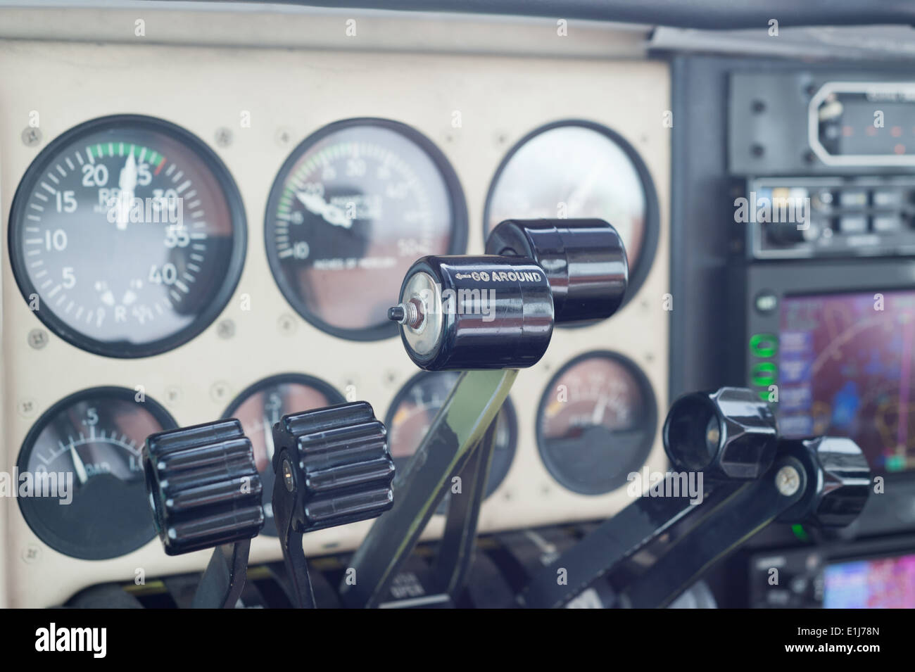 Private Aircraft Instrument Panel and Throttles - all brand names removed - Stock Image