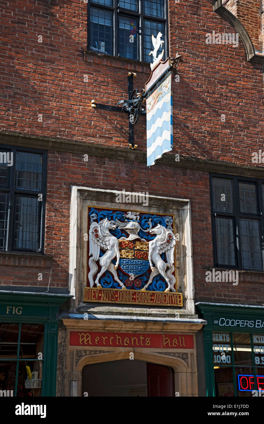Sign and plaque crest outside the Merchant Adventurers Hall York North Yorkshire England UK United Kingdom GB Great Britain - Stock Image
