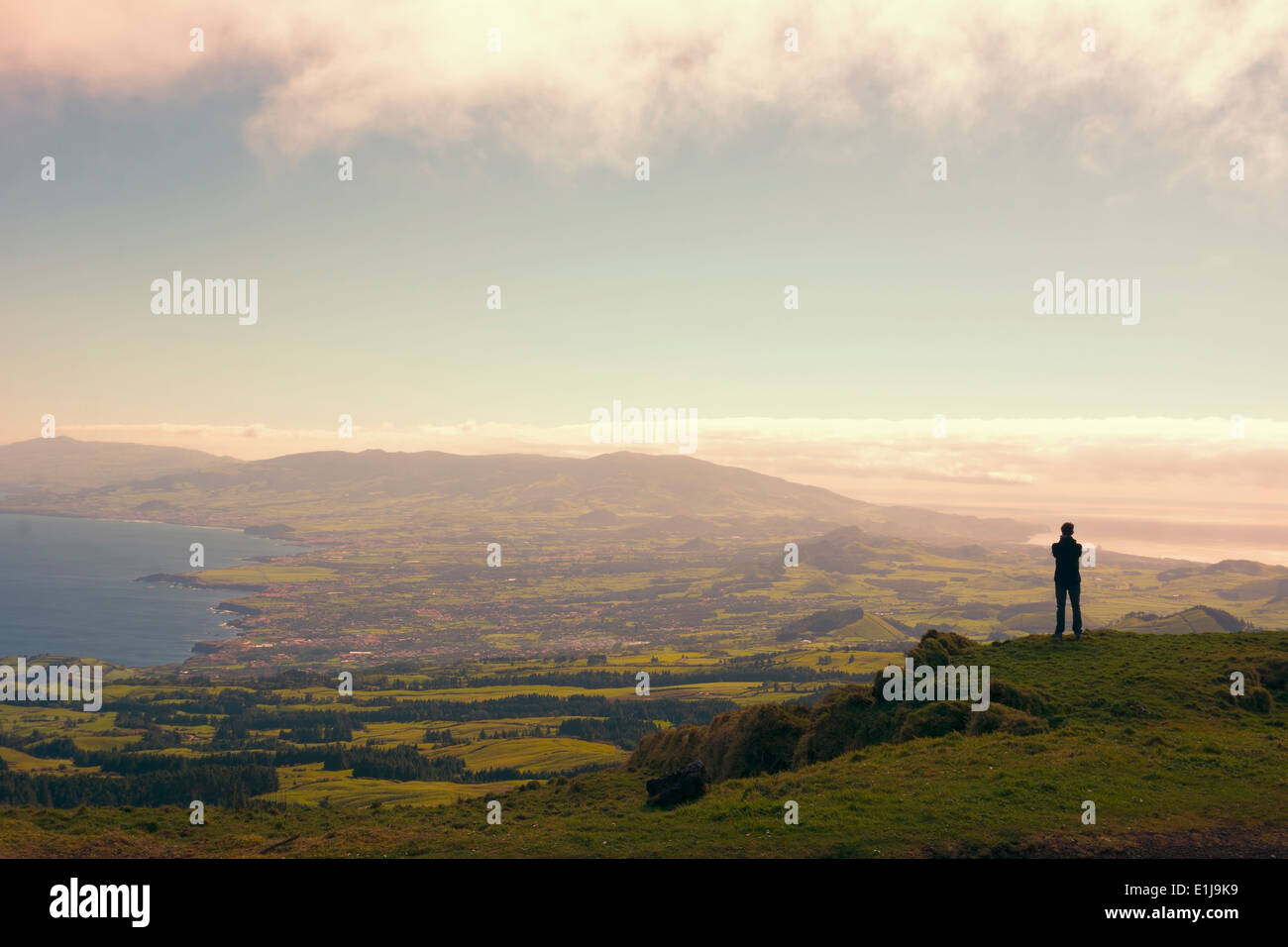 Portugal, Azores,Sao Miguel, Tourist capturing view - Stock Image