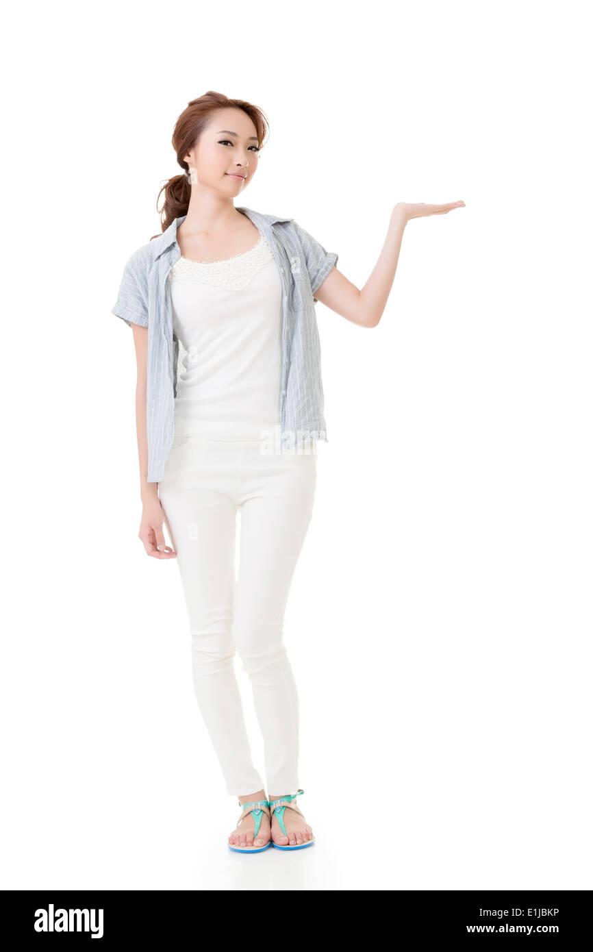 Asian woman introduce something - Stock Image