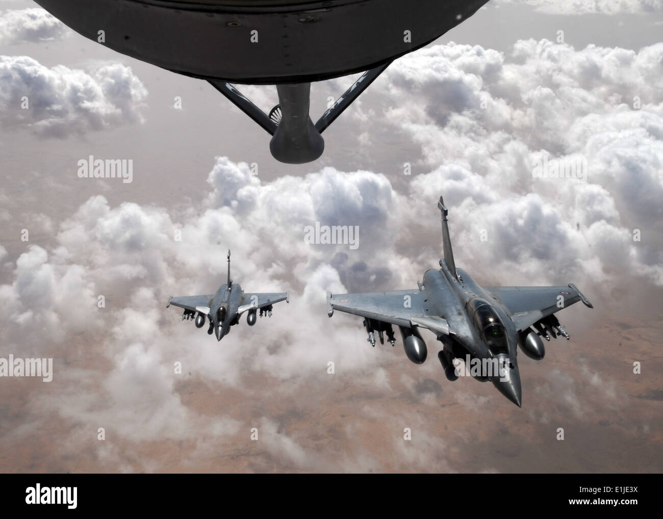 Two French Rafale fighter aircraft prepare to break formation after refueling with a KC-135 Stratotanker April 23, 2013, over M - Stock Image