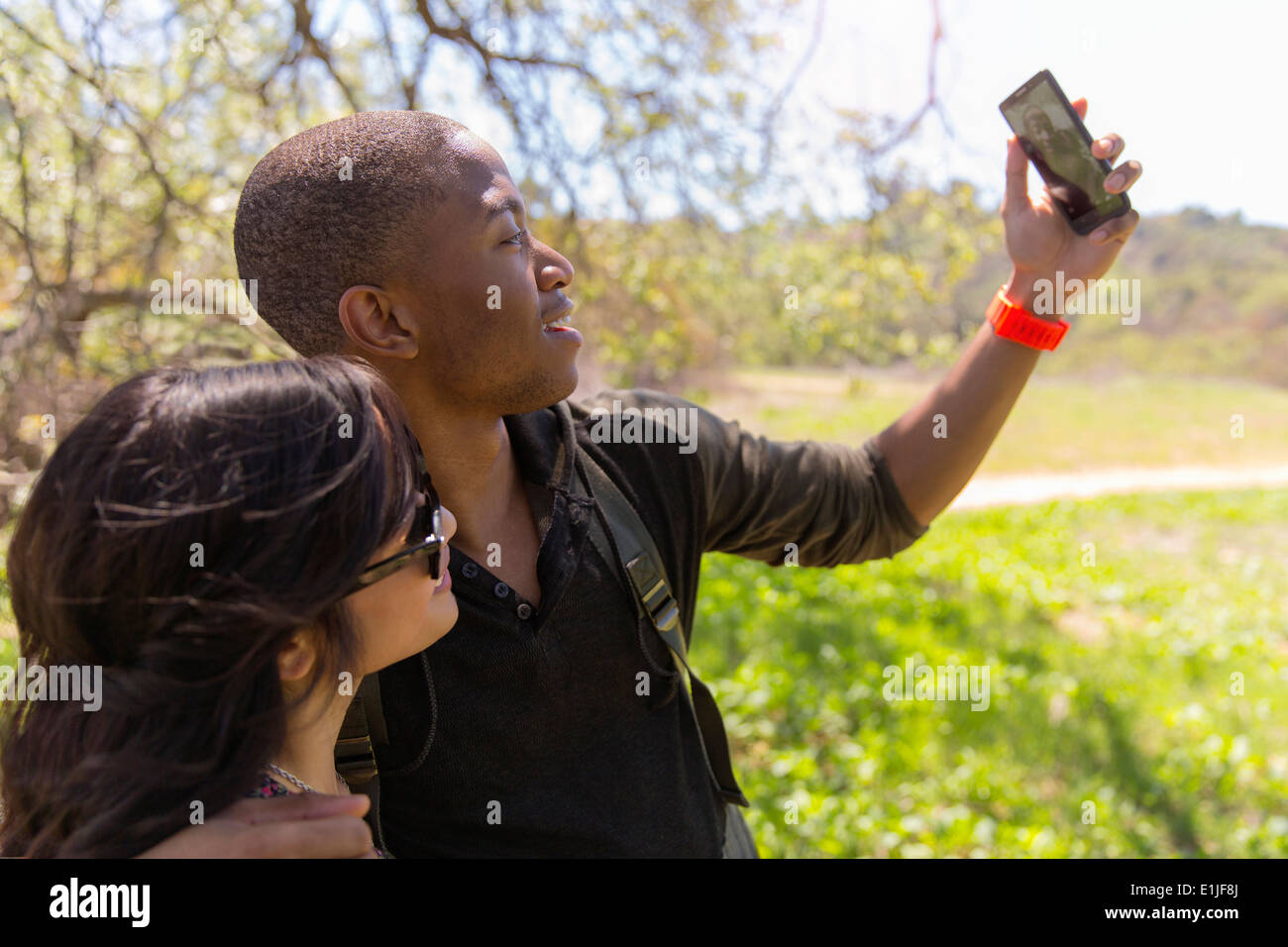Young couple posing for self portrait in park Stock Photo