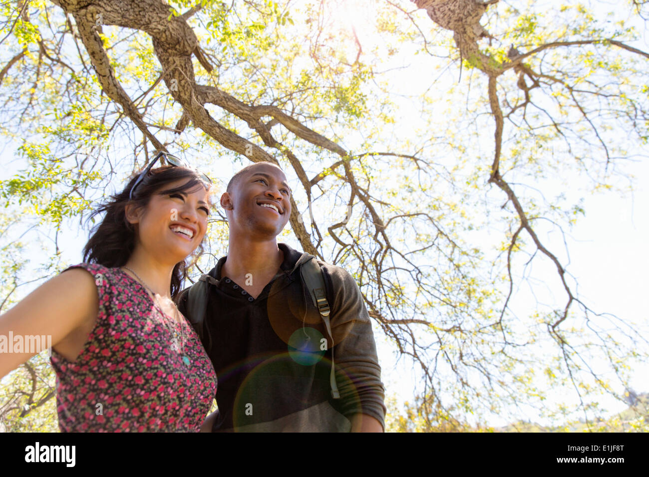 Young romantic couple in park - Stock Image