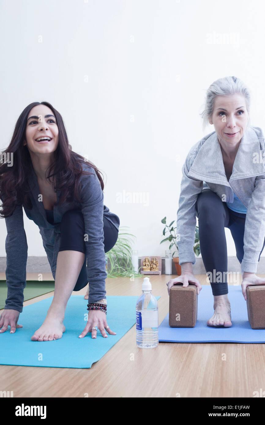 Women practising yoga - Stock Image