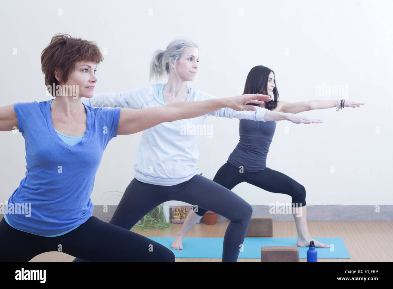 Women in warrior pose - Stock Image