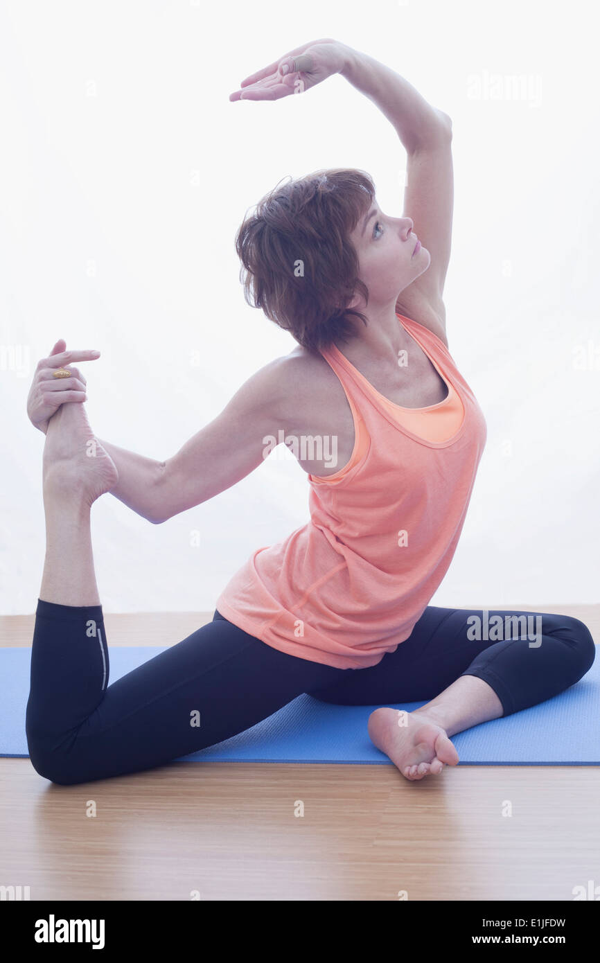 Woman in backbent pose - Stock Image