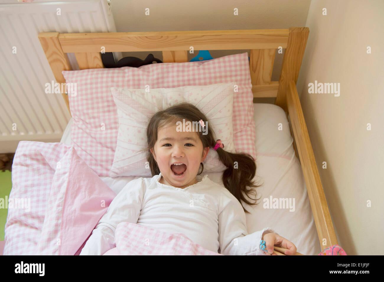 Girl at bedtime - Stock Image