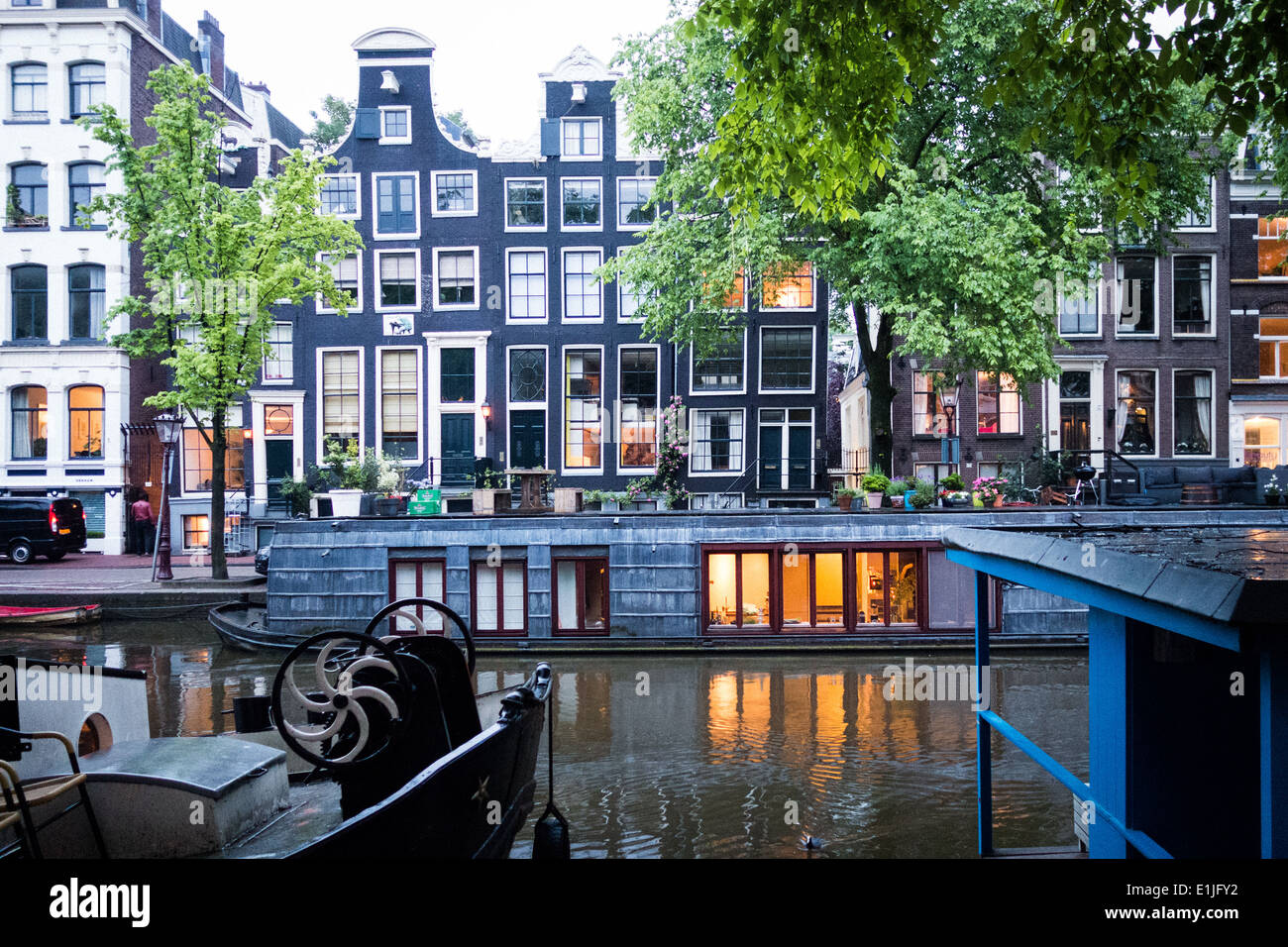 Canal with houseboats in Amsterdam, The Netherlands - Stock Image