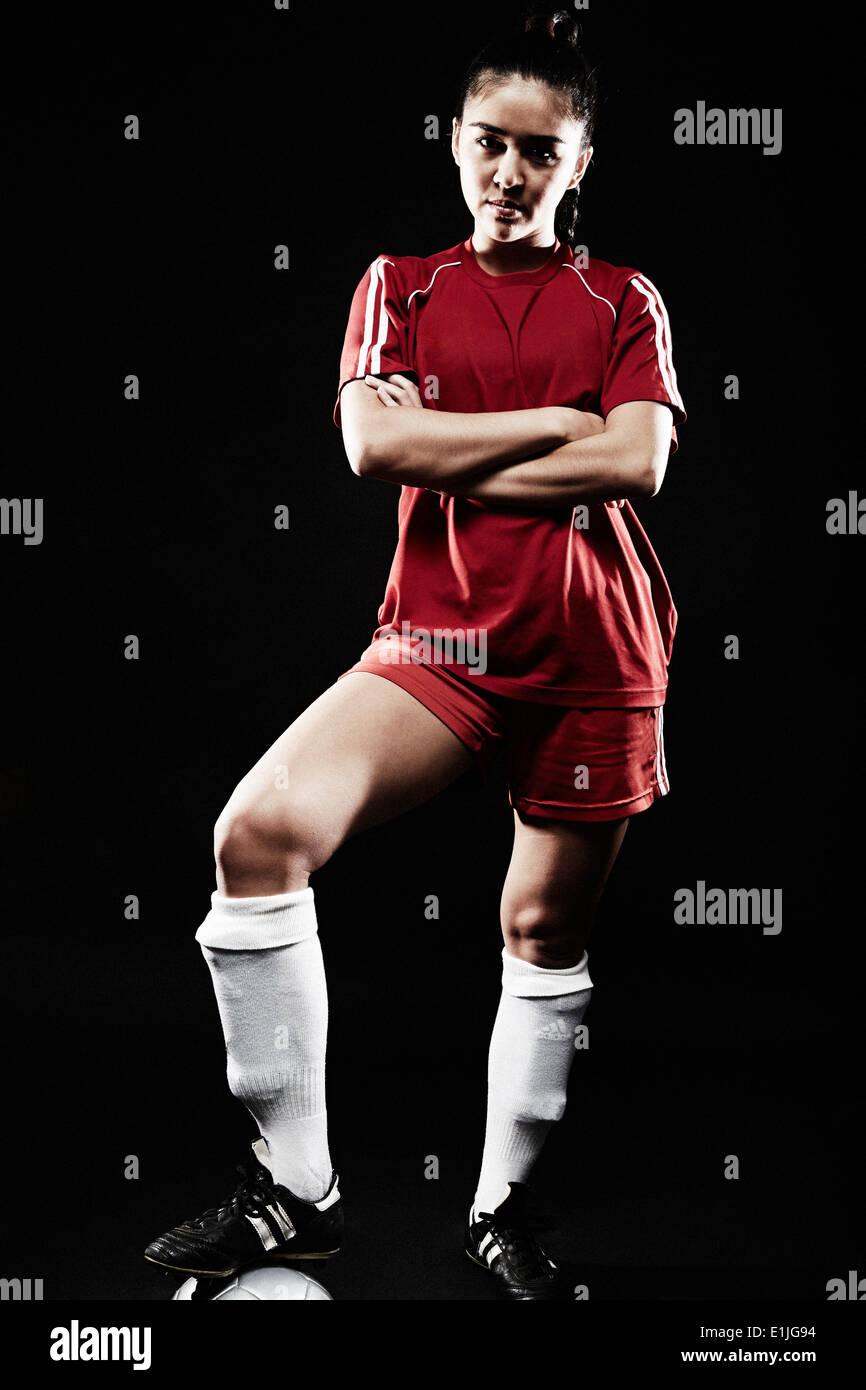 Young woman wearing football uniform - Stock Image