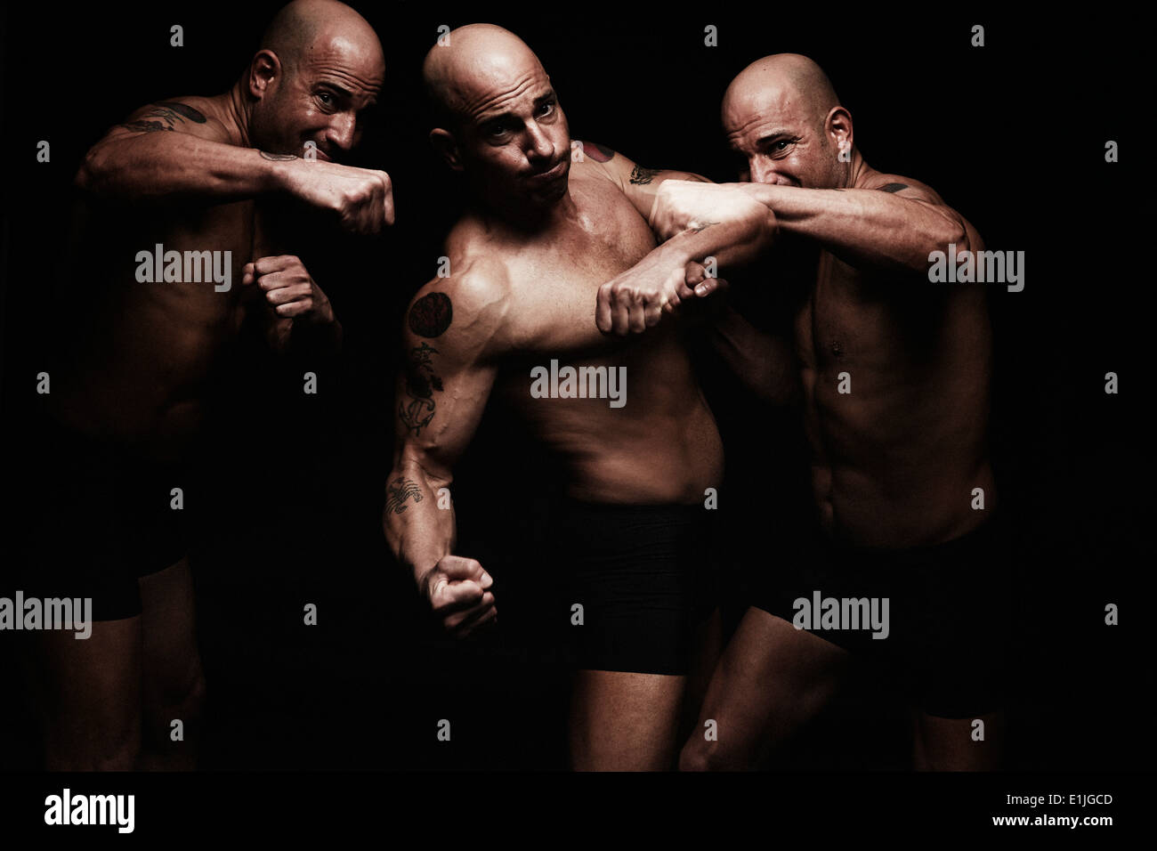 Mature man fighting, composite image - Stock Image