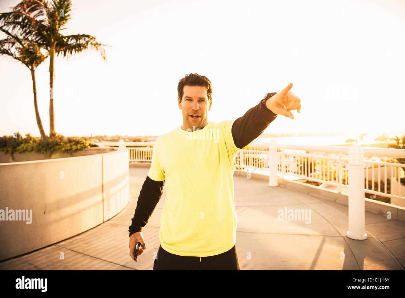 Portrait of confident mature male trainer - Stock Image