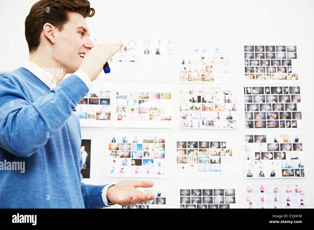 Young man in creative studio - Stock Image