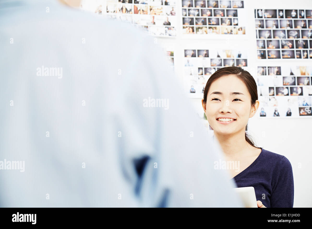Young woman with colleague in creative studio Stock Photo