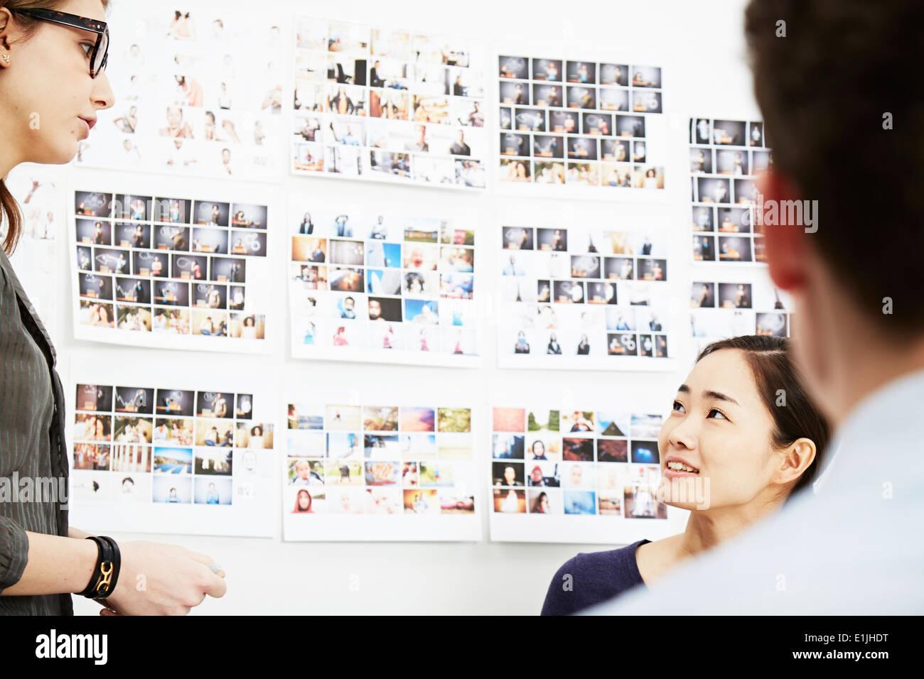 Three colleagues in creative studio - Stock Image