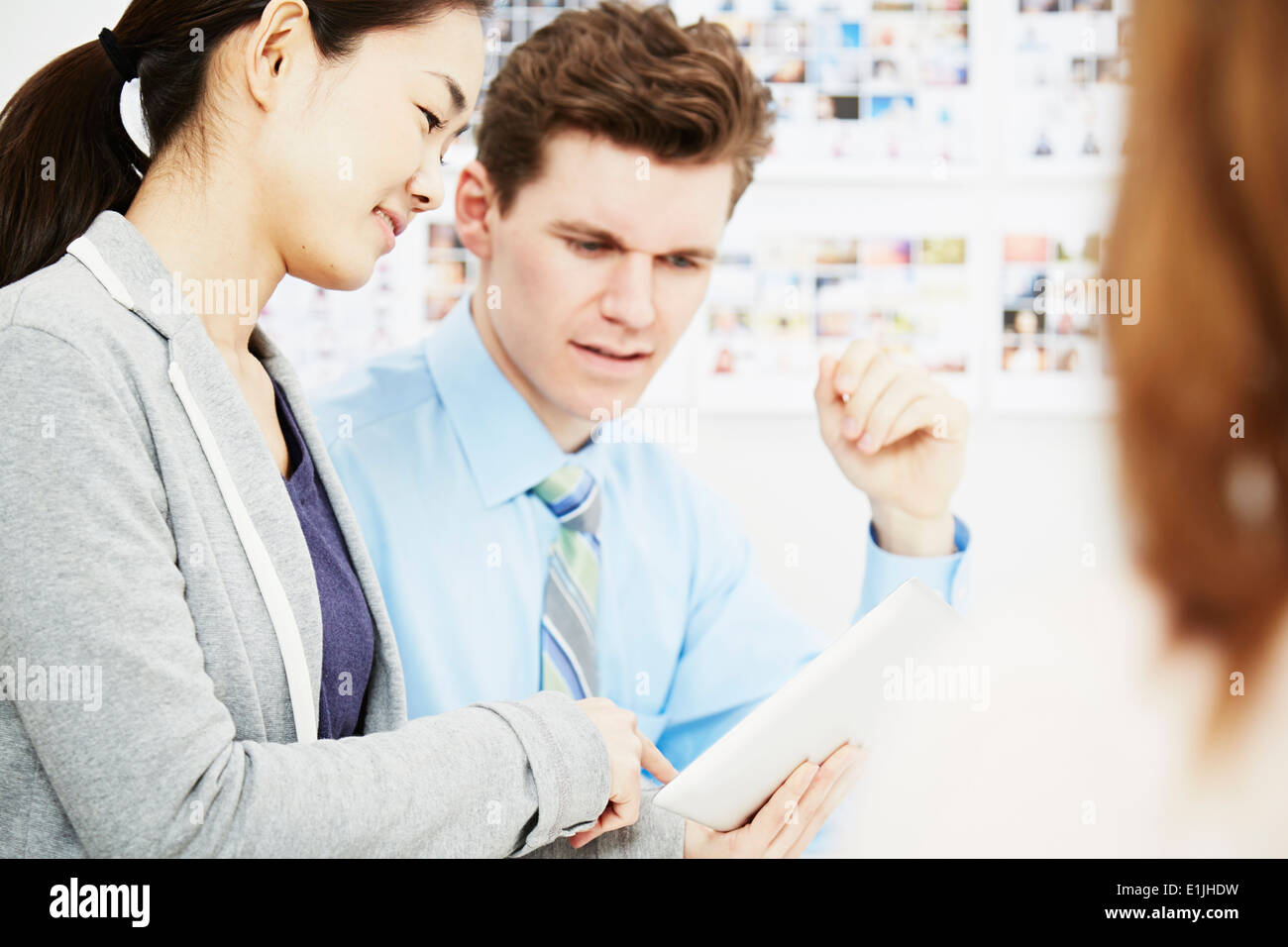Business colleagues in discussion with digital tablet - Stock Image