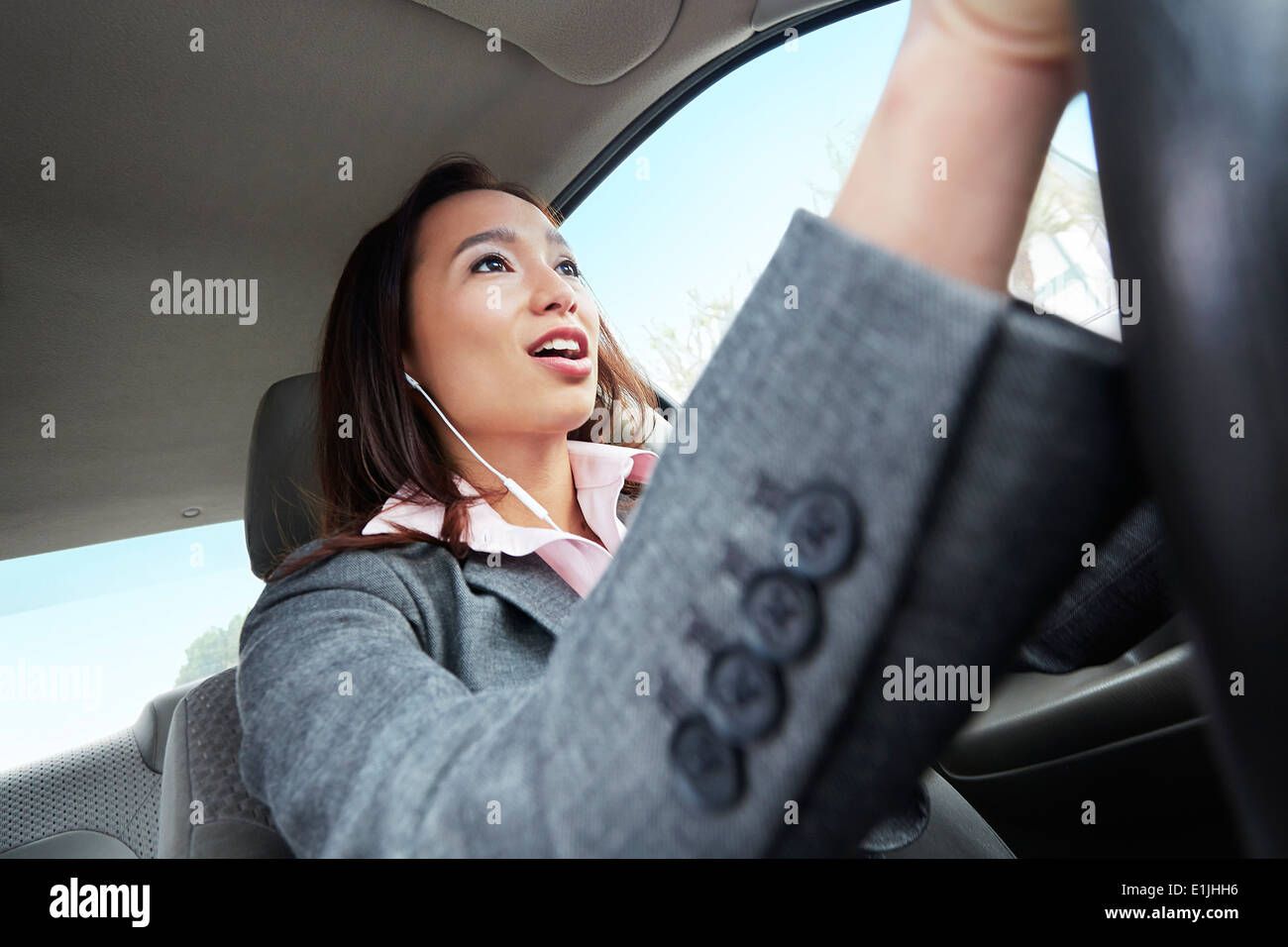 Young female businesswoman driving car - Stock Image