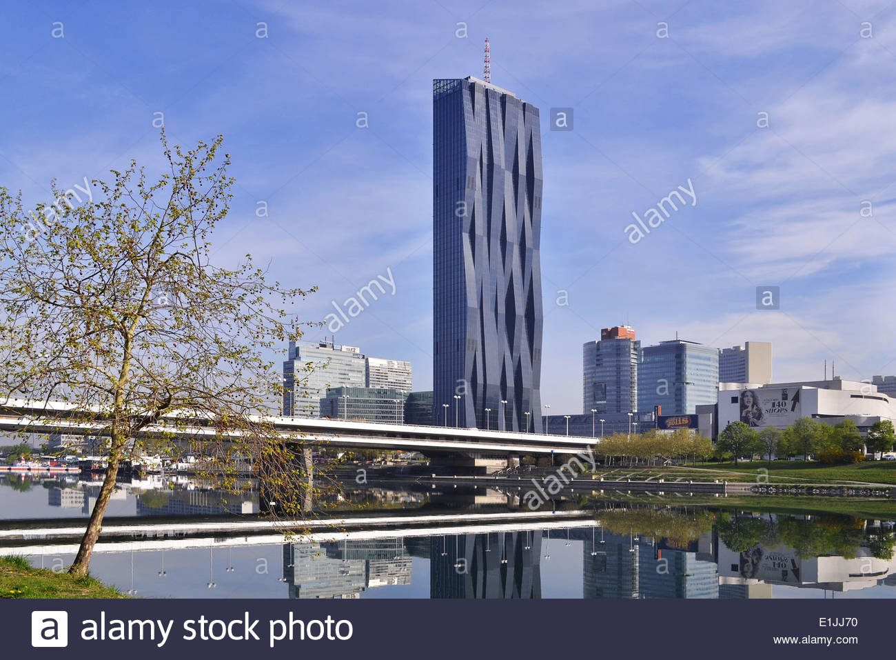 Donau City (DC) Tower 1 - modern skyscraper designed by French architect Dominique Perrault on the bank of river Danube in Vienna Austria Europe. - Stock Image