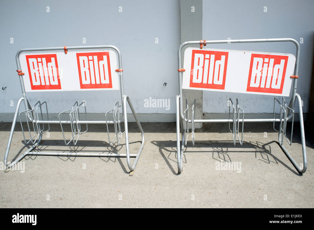 Cycle racks outside a newsagents sponsored by Bild newspaper, Waging am see, Bavaria, Germany. - Stock Image