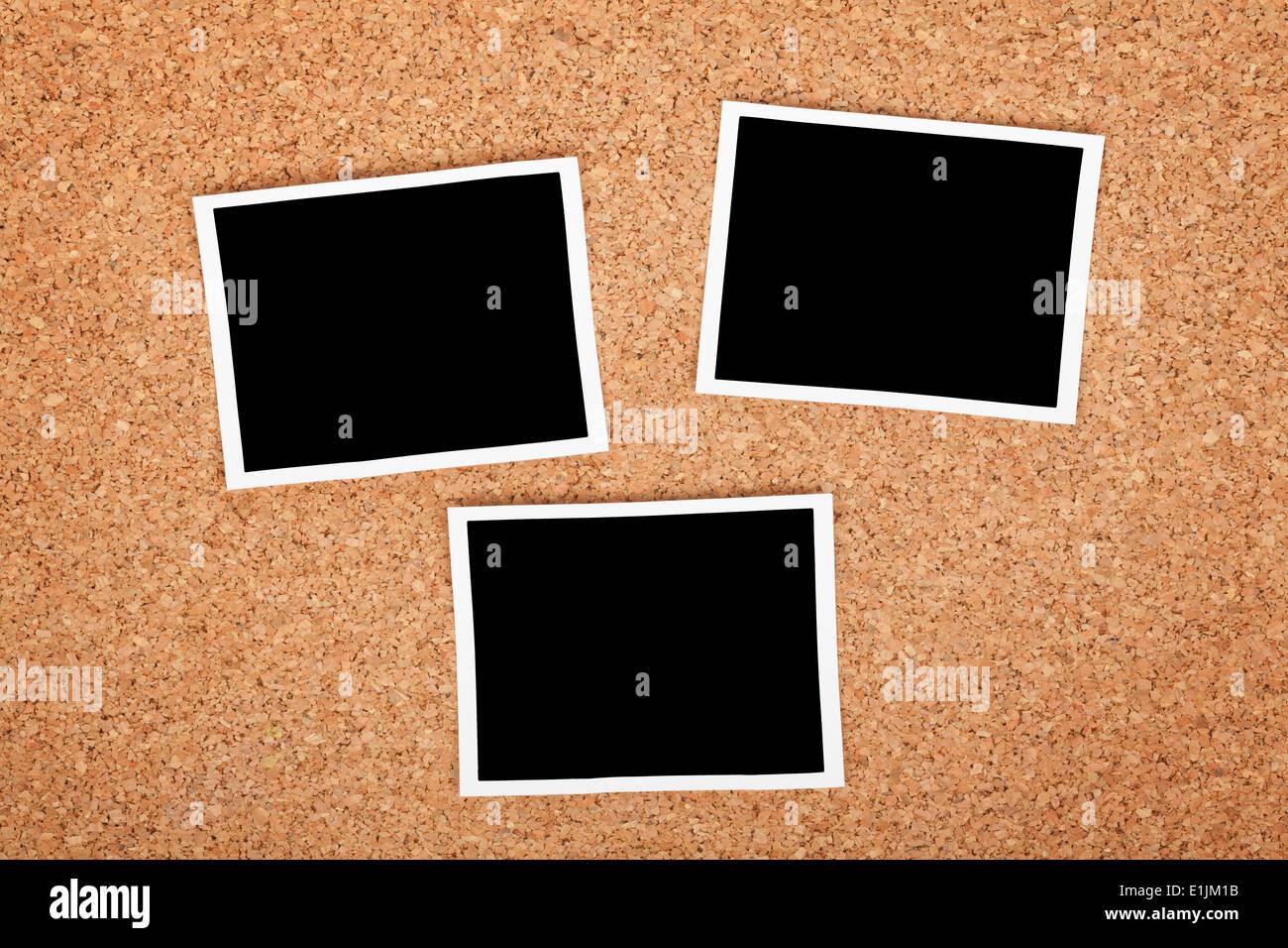 Polaroid photo frames on cork texture background - Stock Image
