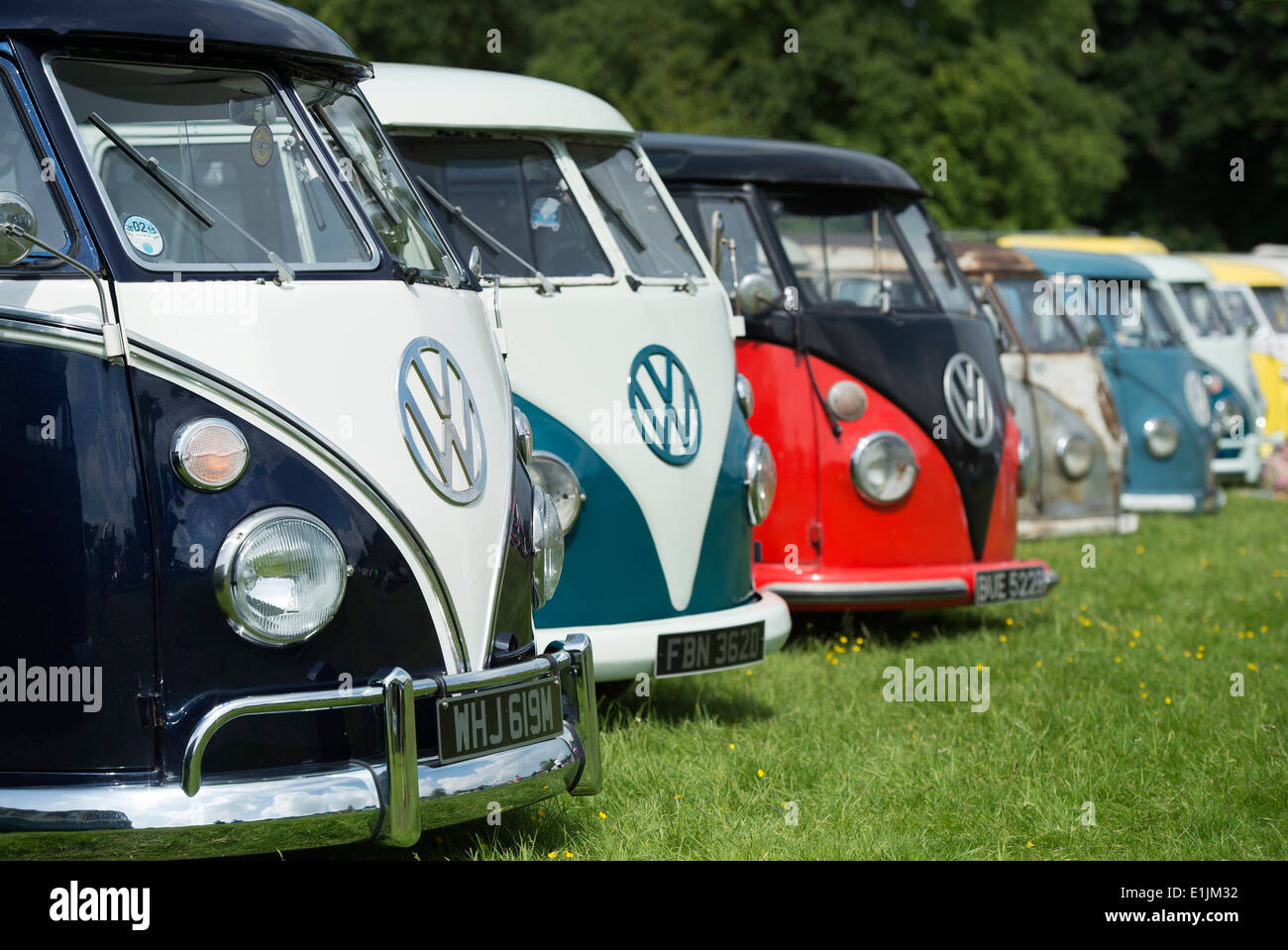 Line of VW Split Screen Volkswagen camper vans at a VW show. England Stock Photo